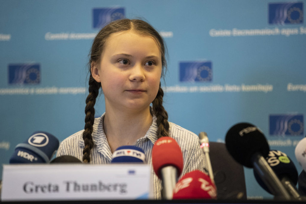 greta thunberg speaking in a conference