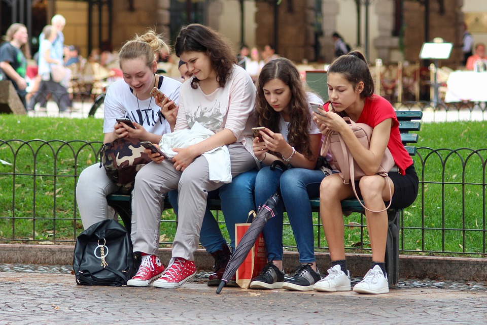 Millennials using their phones; technology